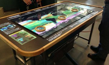 Exploritorium interactive table to display Plankton- could use same design with map of US to visualize and zoom in to data on different epidemics