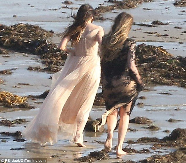 Don't get those dresses dirty! Khloe and Kylie opted for a dash along the sands after the shoot was finished