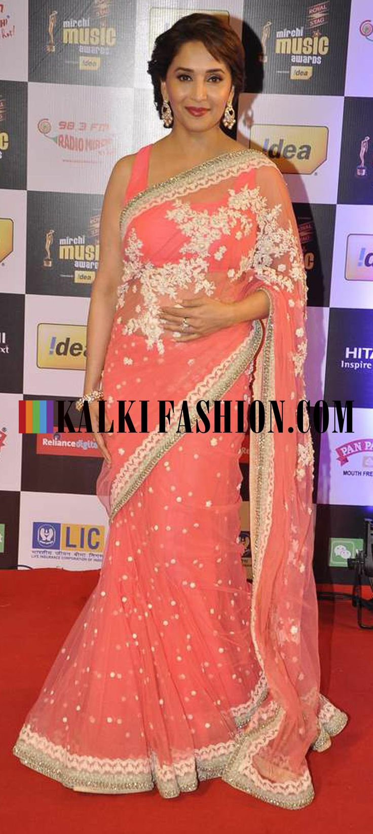 http://www.kalkifashion.com/ Madhuri Dixit Nene looks lovely in a pink lehenga sari by Sabyasachi at Mirchi Music Award 2014