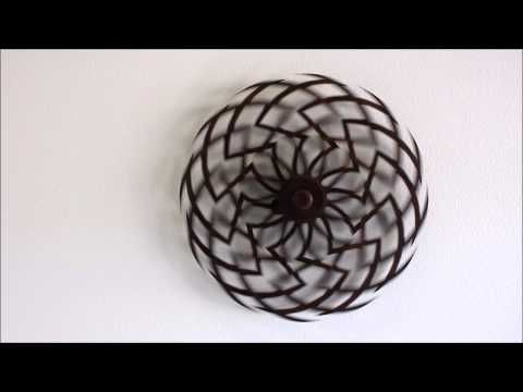 What you're looking at in this short clip is a spring activated kinetic sculpture that can run for up to 40 minutes on a full wind. These Kinetic sculptures are called Zinna, and are the creations of Clayton Boyer. . downvids.com