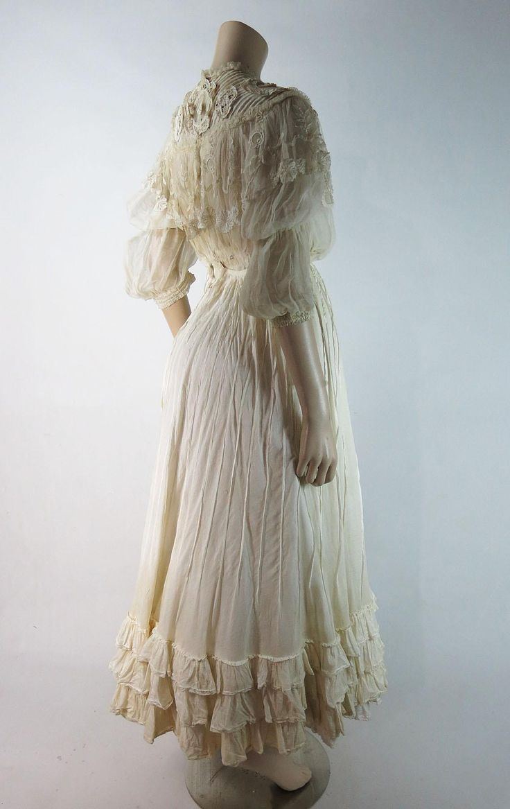 Antique Edwardian lace and organdy dress with a frothy silhouette that features a ruffled skirt and an elaborate bodice with attached capelet,