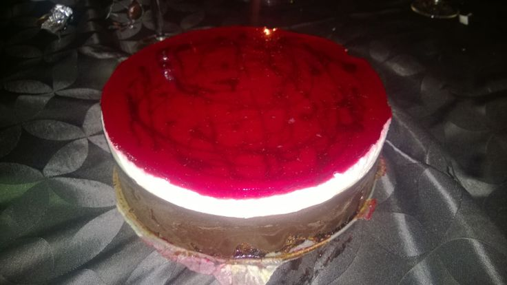 Base of hazelnut with chocolate glaze,  champagne mousse and raspberry jelly