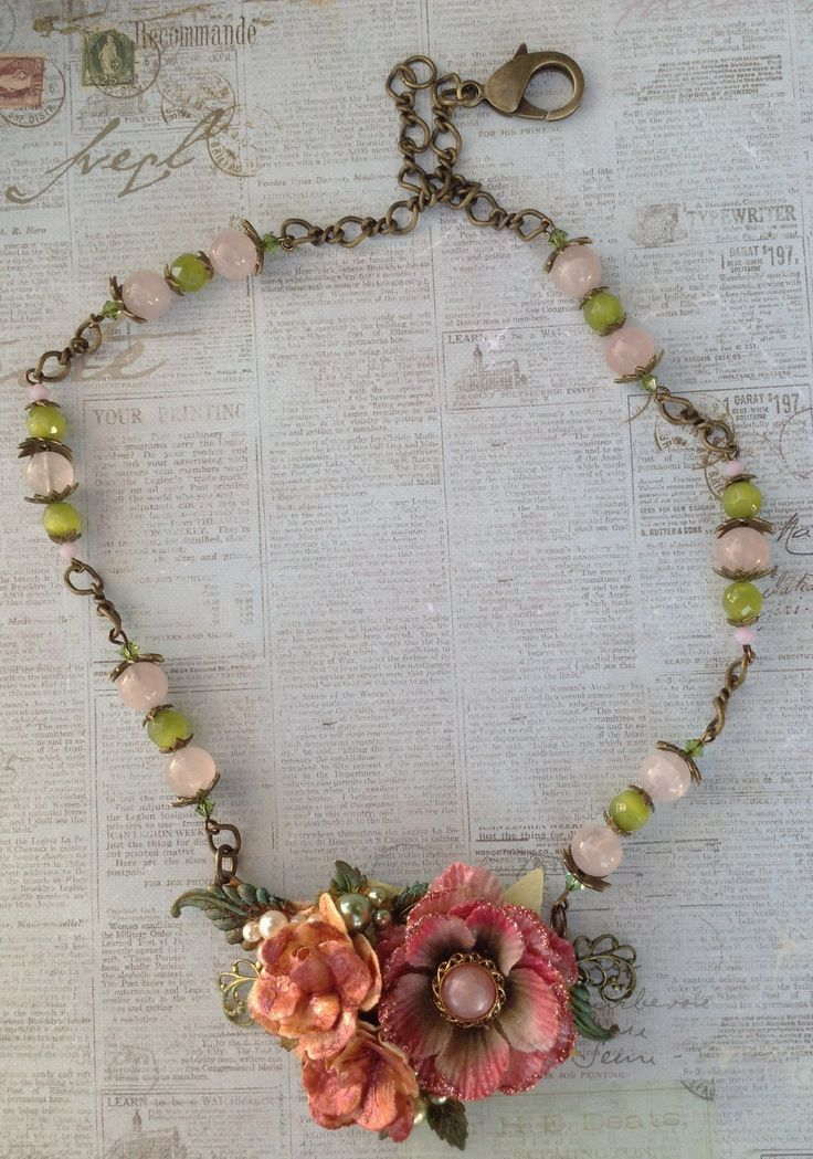 A B'sue necklace blank was used for my focal piece, I used Diamond Glaze on the paper flowers to harden them & a dusting of Perfect Pearls on top of each flower, all leaves are from B'sue, Brass Chain, Rose Quarts,Green Glass Beads & Crystals are in the chain .. Designed by Jann Tague .. Clever Designs .. https://www.facebook.com/JewelsByJann