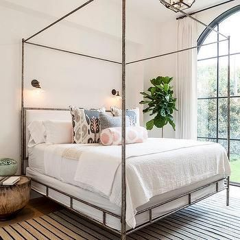 Metal Canopy Bed with Pink and Blue Pillows