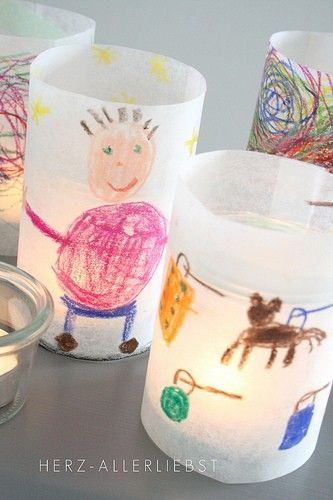 Color on baking parchment paper. Put the paper around glass jars, drop in a tea light candle and you got yourself a personalized lantern - kid's artwork lanterns :)