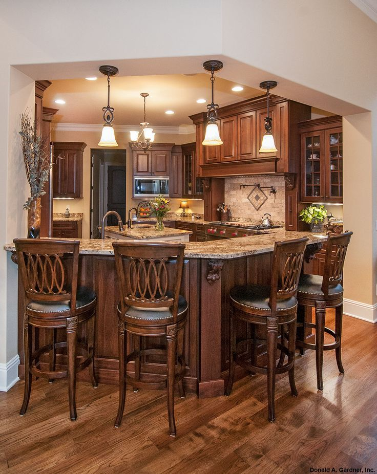 This gourmet kitchen features a bar that comfortably seats four! The Jasper Hill - 5020. http://www.dongardner.com/plan_details.aspx?pid=4229. #Gourmet #Kitchen #Home