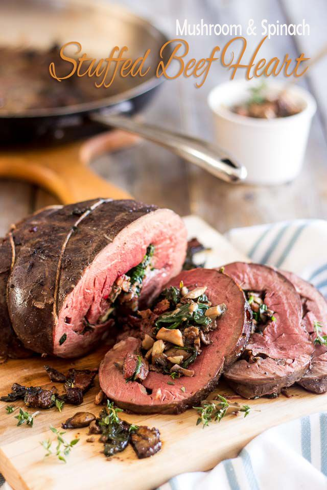 Stuffed Beef Heart | thehealthyfoodie.com  Paleo (of course!), AIP with modifications; great pictures how to prepare a whole heart for cooking.  Recipe contains bacon, onion, mushrooms, garlic, cinnamon, nutmeg and spinach leaves.