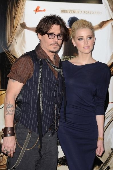 Amber Heard and Johnny Depp http://www.examiner.com/article/amber-heard-and-johnny-depp-bisexual-actress-goes-for-the-guy-again