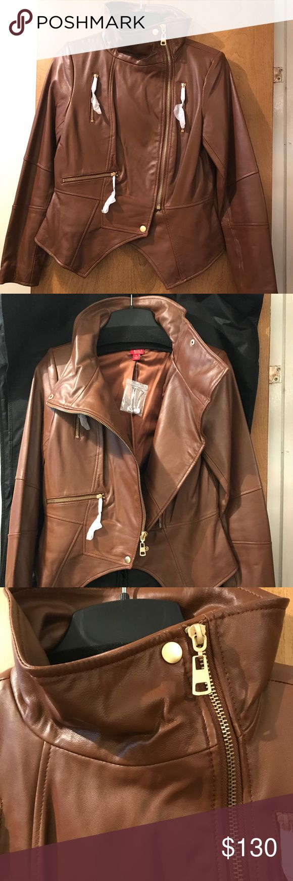 """G.I.L.I. Leather Motorcycle Jacket NEW Brand New G.I.L.I. Leather Motorcycle Jacket in British Tan gold hardware Size 6. From Qvc- item number A256717. Super chic, on trend yet classic. Info from QVC: Slim fit; cut to contour lines of the body. The seam at the waist flatters & defines your shape,designed to be worn comfortably over a tank/shell.If you prefer to wear with a sweater size up. Length: 23-1/8"""" to 24-3/8"""" Content: 100% leather;lining 96% polyester/4% spandex. Comes w/Dustbag…"""