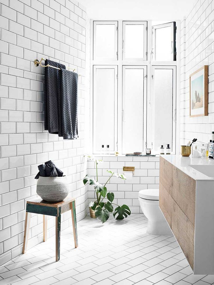 Scandinavian bathroom style with white tile and floating sink via Thou Swell @thouswellblog