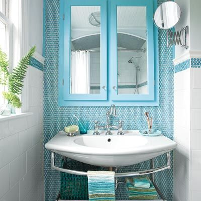 Turquoise penny-rounds, over-sized subway tiles and contemporary fixtures give this bath a timeless, eclectic style. | Photo: Jan Warpole | thisoldhouse.com