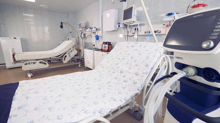 Hospital beds with medical equipment near them at …