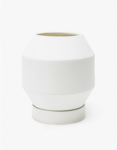 From Areaware, a clean, modern planter in White. Softened geometric shape. Matte glazed exterior contrasts a glossy interior. Included cylindrical saucer in a glossy finish.   • Porcelain  • Two pieces • Hand wash