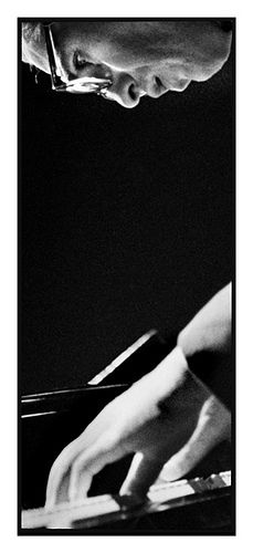 Bill Evans | by Roberto Polillo.  In the spring of 1958, Evans began an eight-month gig with the Miles Davis Sextet.  He was deeply involved in the planning and execution of Davis' epochal Kind of Blue album in 1959, contributing ideas about mood, structure, and modal improvisation, and collaborating on several of the compositions. The album  contains some of the most moving performances of Evans' career.