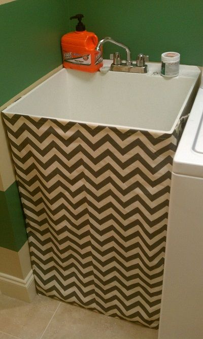 Cover up sink plumbing with a sewn skirt.