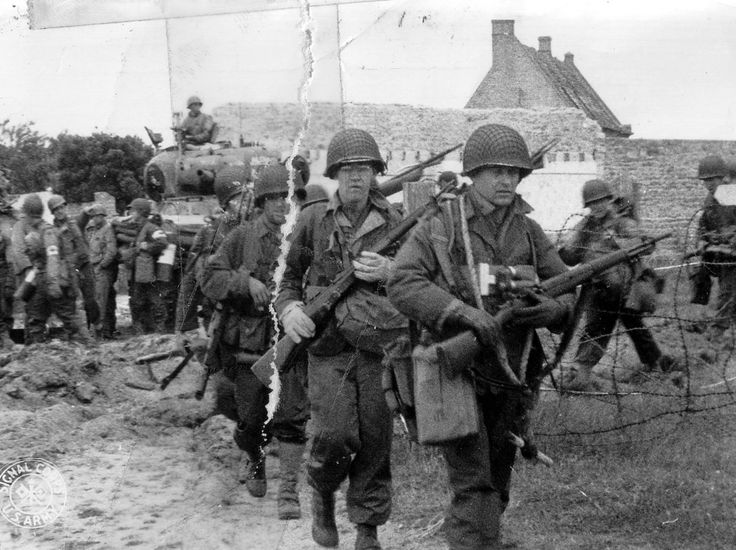 U.S 4th Infantry Division move inland after securing Utah Beach.