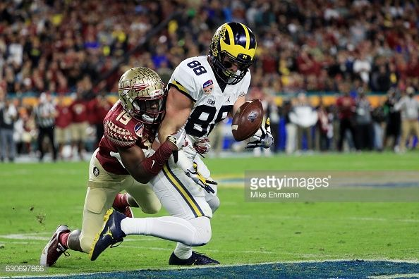 News Photo : Jake Butt of the Michigan Wolverines completes a...