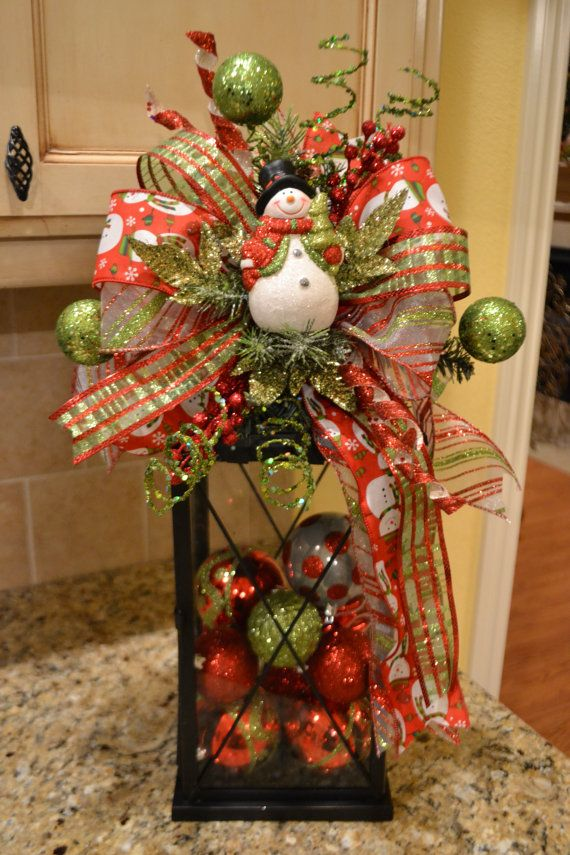 It wont be long until its time to decorate for Christmas! Dress up your lantern with a fun and festive snowman swag. This swag attaches to your