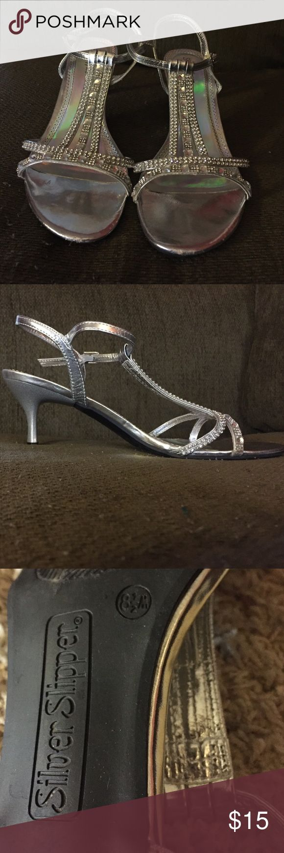 Silver Slipper 1-1/2 Inch Heels Only worn once for prom. Minimal damage on both shoes on the front toes (as pictured). Absolutely loved them! I still have and will include the box. Size 8-1/2, medium width. Shoes Heels