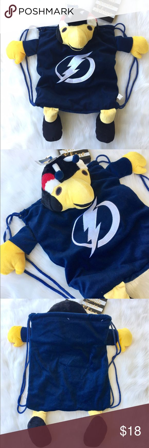 NWT NHL Tampa Bay Lightning Backpack NWT NHL Tampa Bay Lightning Backpack This is a cute fun and versatile backpack that is great for game day.  One size, new with tags that has a ton of room!                                   🤔 Please ask all questions ✅Use Offer Button 🚭& 🐶😺🐠Free Home 🚫Trades/Offline Transactions 📦Bundle & Save Nike Accessories Bags