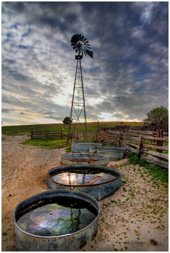 old windmill and watering troughs