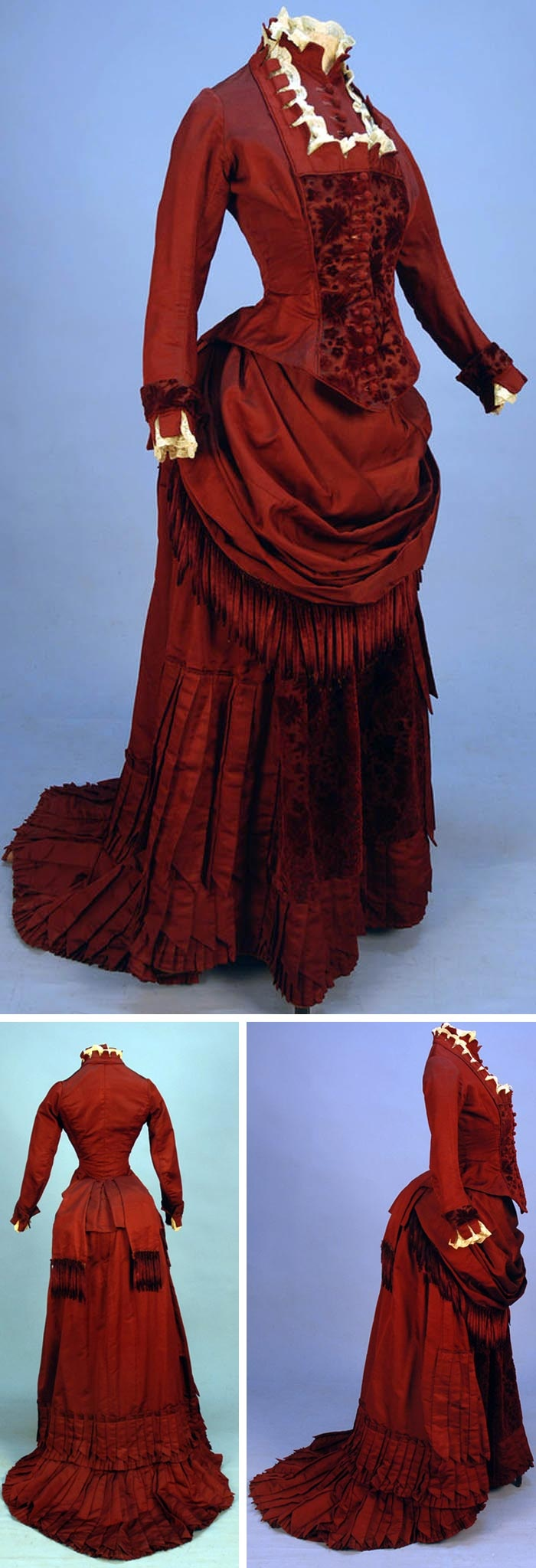 I so like this! Can't wait to dress one of my characters in it............Circa 1880 silk and velvet bustle dress with fringe, claret-colored ottoman with self-piping, lace, and crenelated trim at neck, Bib front and cuff, floral cut velvet bodice, and skirt front panel. Draped skirt trimmed in chenille fringe and pointed pleats, crocheted buttons, and polished cotton lining. Via Whitaker Auctions.