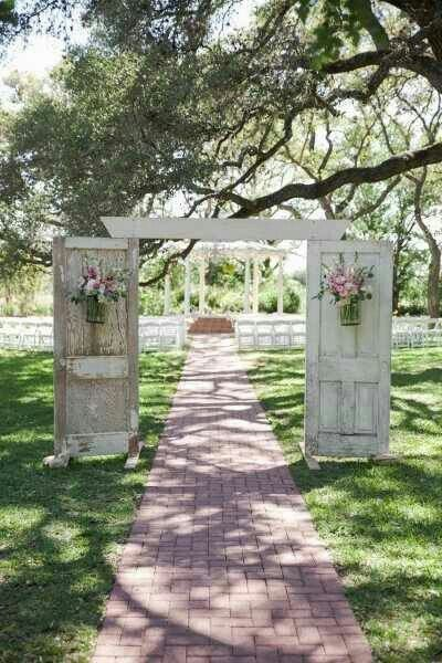 Two old doors making a wedding aisle arch.  Love this!  #wedding #antiques #doors #vintagewedding