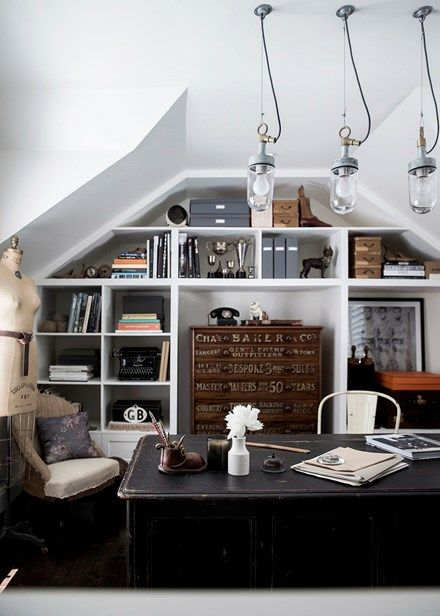 One of the owner's favourite pieces is the 1920s mahogany tall boy in the upper-level attic, which serves as a home office and is surrounded by vintage objects. Home Beautiful