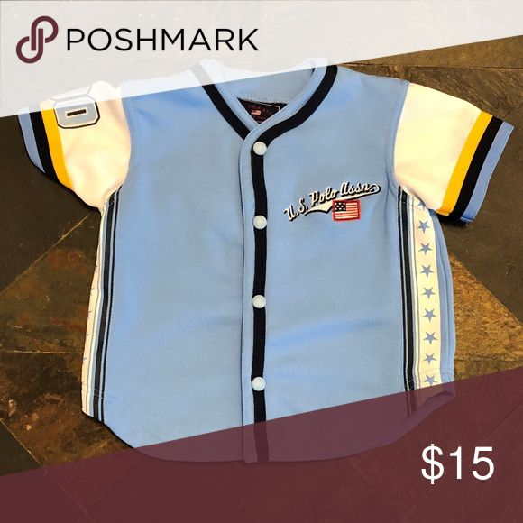 US Polo Assn Baseball Jersey U.S. Polo Assn. National Baseball League Jersey. The blue jersey is accented with a US Flag, stars #90 and a baseball emblem on the back. The front closes with snaps. Polo by Ralph Lauren Shirts & Tops