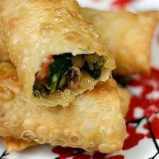 Deep-fried egg rolls filled with black-eyed peas, collard greens and bacon...