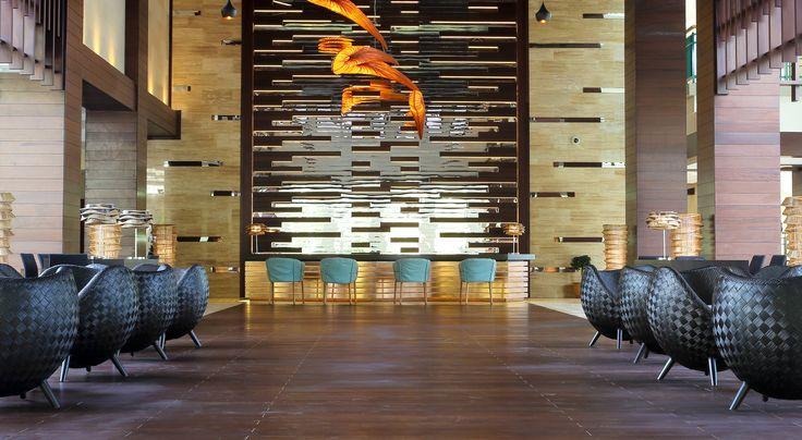 Pendant lamp. Aqua Creations Lighting & Furniture Atelier. KORAKOT AROMDEE DESIGN - Table lamp made of Seesuk bamboo. KENNETH COBONPUE - LA LUNA - Easy Armchair - Shell of rattan core and jute, chair, Occasional table & Ottoman. VARASCHIN - ORSAY TABLE - GORDON GUILLAUMIER DESIGN #AquaCreationsLighting #KORAKOTAROMDEE #KENNETHCOBONPUE #VARASCHIN  #Realized #Design #Project #Interior #Reception #Exotic #Furniture #Lighting #Architect and #Designer #Pavlovskaya #vashurkindesign.com