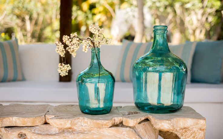 Outdoor seating at our Ibiza Finca - the Turquoise coloured glass against the driftwood table looks so crisp clean and fresh. Turquoise is the colour of Ibiza some say - at Morna retreats Ibiza we agree. #mornaretreatsibiza