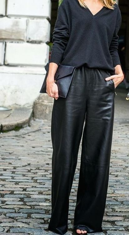 Edgy look   Black sweater and loose leather pants