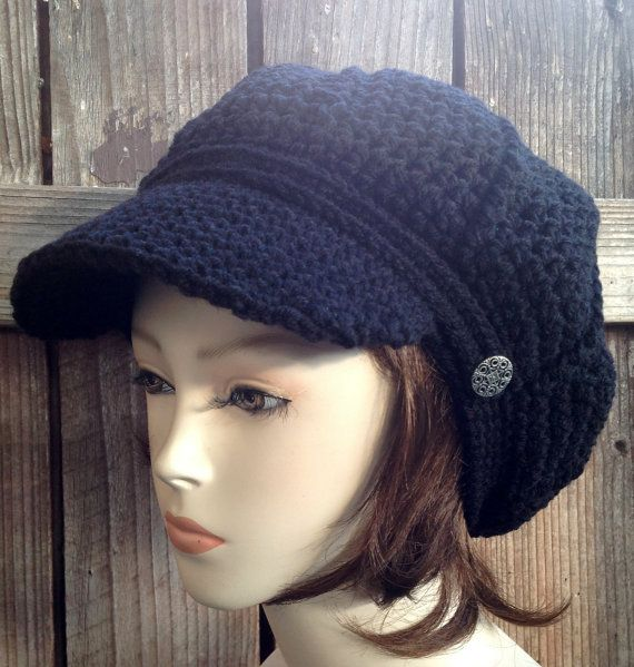 This is a black newsboy style hat made in crochet it a slouchy Newsboy, which means that its made to be a little puffy in the back to add volume to the head. It also allows to put all the hair in side the hat. Its made by WoolFashion and its sold for $28.00