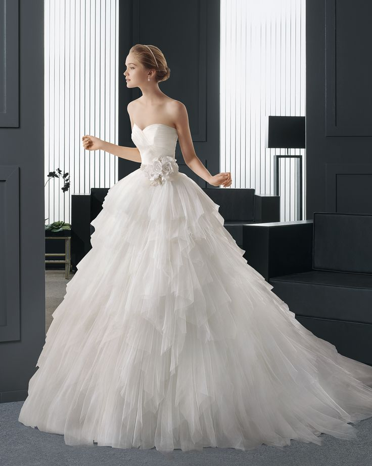 Same lovely, ruffly wedding gown by Two by Rosa Clara, different view. I love the flowers at the waist.