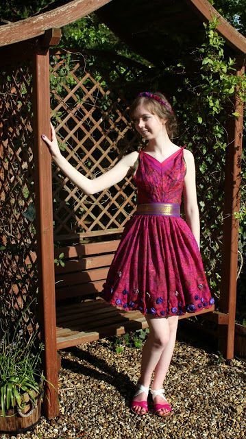 Leavers ball dress with draped pleated bodice, gathered skirt and with 3D roses scattered around the hem. Made from a vintage sari.