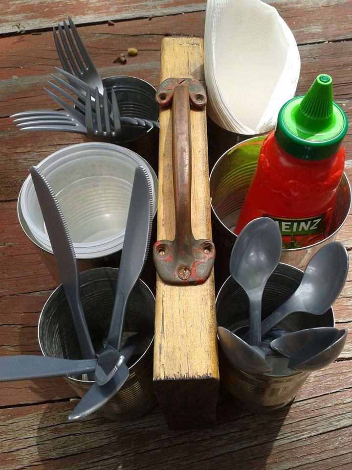 BBQ utensil holder made from recycled wood, tins and an old drawer pull.