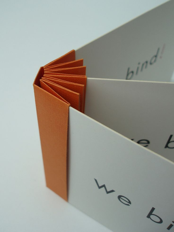 Elbum __ insert cards into fold, when full the cards are pinched and hold in place.