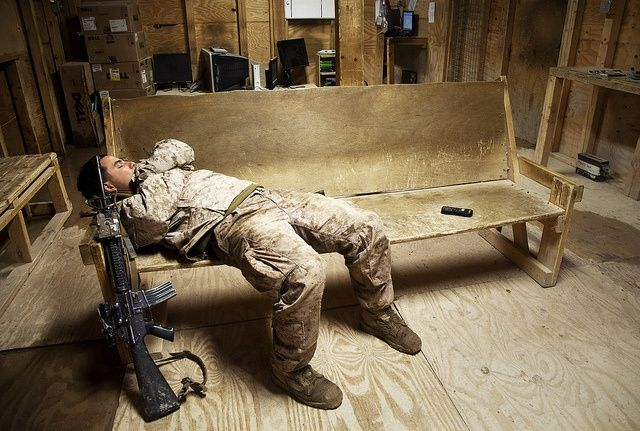 Rest for the Weary by United States Marine Corps Official Page, via Flickr. A Marine assigned to Fox Company, 2nd Battalion, 7th Marine Regiment (2/7), takes a nap in the Morale Welfare and Recreation (MWR) center on Forward Operating Base Now Zad, Helman