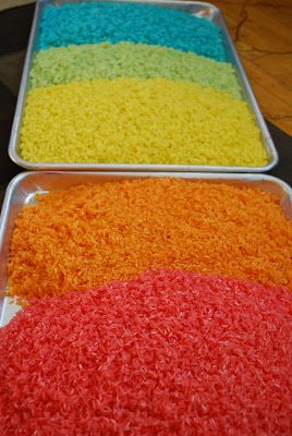 Rainbow Rice - For each color of rice:, 4 C uncooked rice, 3 T rubbing alcohol, 2 small globs of food color gel or 2 T liquid food coloring 1.  In a gallon size ziploc bag, combine all three ingredients.  Remove the air and zip close.  Smoosh and mash the bag until the color is evenly distributed. 2.  Pour onto a cookie sheet and allow to dry completely.  It helps drying time to stir it occasionally.