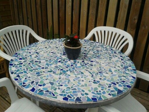 Upcycled glass patio table.  Made with broken tiles.