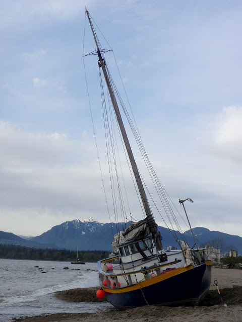 Kits Beach. What is the boat doing there?!