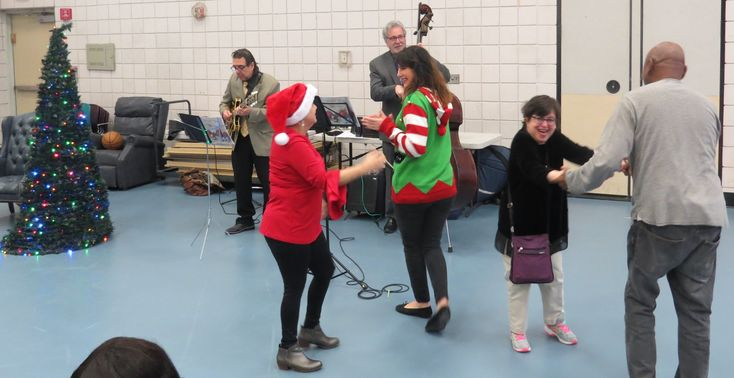 Cerebral Palsy of Westchester's Adult Program enjoyed a cheerful holiday performance by three performers on December 22nd, 2017. Vocalist Alexis Cole, bassist Fred Berman, and guitarist Tom DiPietra sang and played a variety of holiday songs to get everyone in the holiday spirit. The gym was full of individuals and staff singing and dancing along. Happy Holidays & a very Happy New Year from CPW!