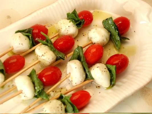 Tomato, Basil & Mozzarella Skewers - Buy container of marinated mozzarella balls, add balsamic vinegar, cut cheese & grape tomatoes in 1/2, return to marinade overnight. :)  Skewer with fresh basil!  Wallah Wonderful!