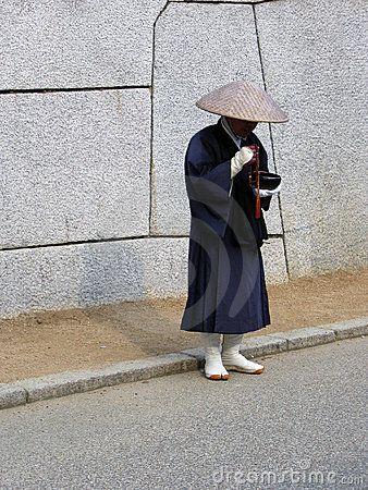 street performer dressed in traditional Chinese/Japanese peasant costume in Oaska, Japan