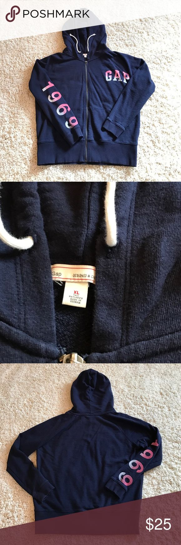 Woman's XL Navy Blue Zip Up Gap Hoodie This is a great navy blue zip up hoodie from the Gap! It is a woman's XL and is in brand new excellent condition! It was never worn but was washed once! It says Gap in an ombré of pink and white at the top left and 1969 in the same ombré on the right arm! It has draw strings on the hoodies as well! It is 💯 cotton! GAP Tops Sweatshirts & Hoodies