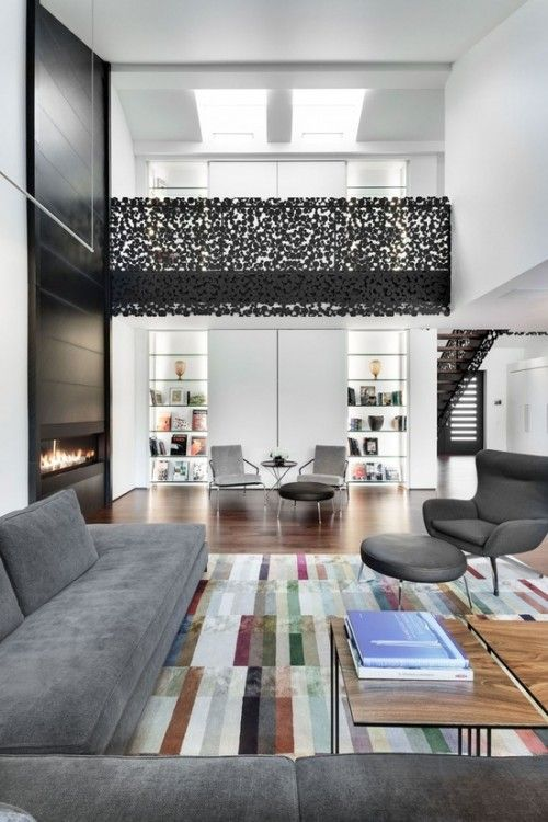 12 Loft Mezzanines: Gestion René Desjardins designed this residence, dubbed the Maison du Boisé, in rural Quebec, Canada. The objective, to be modern but not minimal, was most definitely achieved. The lacy iron mezzanine rail is a whimsical touch.