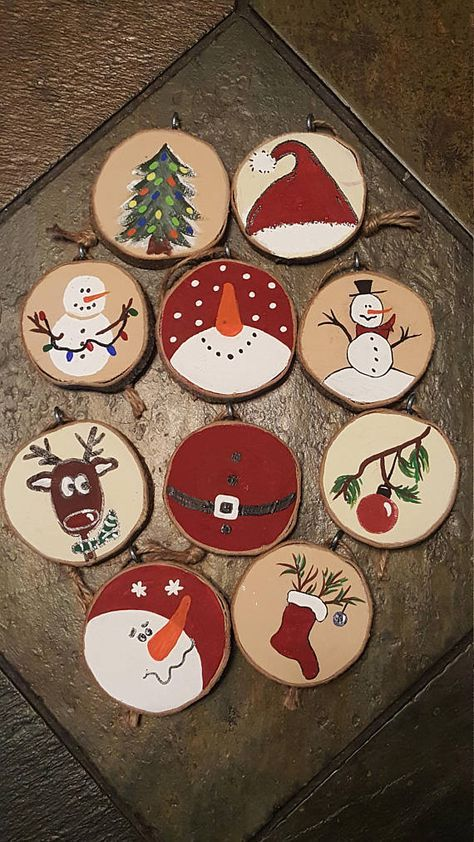 Just in time to decorate your Christmas tree! Set of 10 ornaments made from wood slices (wood was obtained secondhand though we believe it is boxelder). One side is natural wood and the other side is painted with acrylic paint. Each ornament has a different Christmas design with