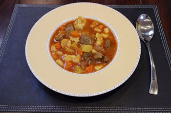 Authentic Hungarian Goulash recipe with step-by-step photos and cooking tips, spiced up with history and facts about Hungary's most popular dish.