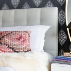 White Tufted Headboard With Gray And White Wallpaper Accent Wall